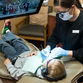 Child getting dental work by female dentist